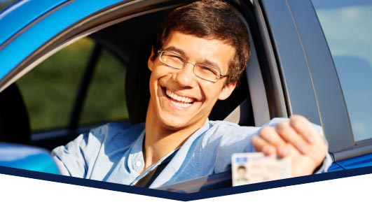 Happy male G2/G driver holding driver's license
